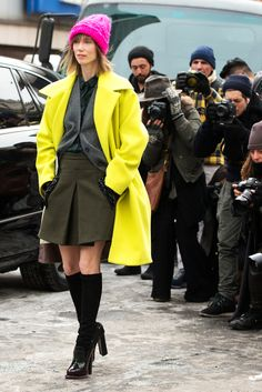 70 Looks From The Fashion Olympics #refinery29  http://www.refinery29.com/ny-fashion-week-street-style#slide1  A neutral schoolgirl outfit gets an electric shock in the form of an acid-yellow coat and a lipstick-pink beanie.  No. 21 Cesira Chartreuse Coat, $1,250, available at Moda Operandi.