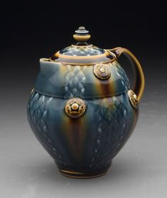 I adore this pitcher by Ryan Greenheck.  The colors are right up my alley and the overall look is stunning.