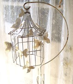 Antique Wrought Iron Bird cage and Stand. Paper Butterflies.