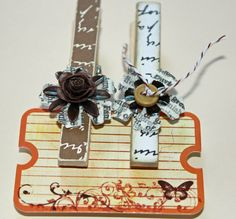 Altered wooden clothes pin with metal flower embellisment