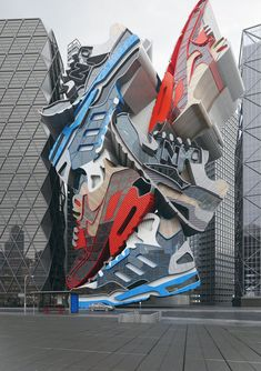 """""""Sneaker Tectonics"""" by UK-based artist Chris Labrooy is a monumental-scale sculpture of enormous stacked sneakers that is actually an incredibly convincing 3D graphic."""