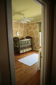 Giraffe nursery walls! This is so calm and still very giraffe. :) thought of you when I saw it.