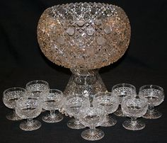 CUT CRYSTAL PUNCH BOWL & SET OF TEN GOBLETS