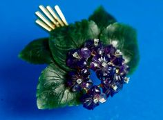 An Art & Crafts Period Suffragette Spray Brooch Pin of Carved Amethyst, Diamond and Nephrite set in 14 Karat Gold