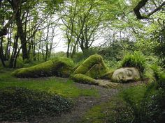 """Mud Maid"" Sinking Sculpture Illusion at the Lost Gardens of Heligan, UK"