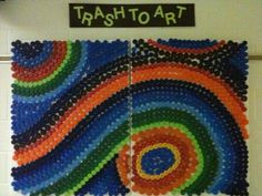 These are plastic bottle caps. What a great craft , recycling art project.
