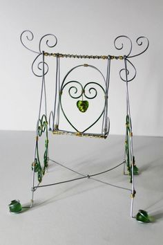 A wire swing made for children by Twisted Wires.