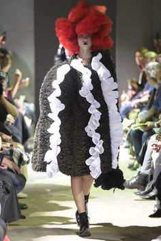 Feminine ruffles gave spring looks a touch of fancy and romance.  Comme des Garçons RTW Spring 2016