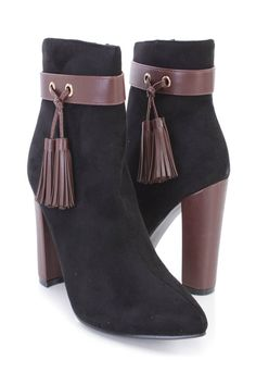 Stay warm and stylish in these sexy single sole high heel booties! The features include a faux suede upper with a pointed closed toe, center seaming, faux leather ankle strap with side tassels, stitched trim, inner side zipper closure, smooth lining, and cushioned footbed. Approximately 4 inch heels.