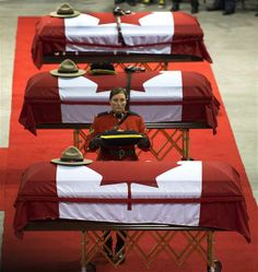 The caskets of the three RCMP officers who were killed in the line of duty are draped witth the Canadian flag at the regimental funeral at the Moncton. Quebec, Dave Ross, Moncton Nb, Toronto, Canadian Things, The Line Of Duty, National Police, Naval, Popular People