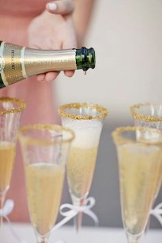 cheers with gold rimmed champagne.*My Tommy Hilfiger NYE*