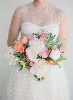 The bride for this modern garden wedding in Ojai carried a bouquet of poppies, peonies, garden roses and other wildflowers with greens in a mix of spring colors | Bob Gail Events #bridalbouquet #ojaiwedding