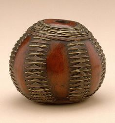 Africa | Snuff container from the Zulu (South Africa), Shona (Zimbabwe) or Tsonga (Mozambique) people  |  Gourd, brass wire | Late 19th to early 20th century