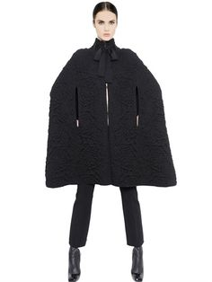 Quilted Rose Knit Cape High collar with self tie closure Concealed front hook closure Unlined Sample size: 38 Made in Italy