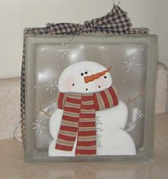 snowman painted on glass block