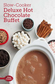 Slow-Cooker Deluxe Hot Chocolate Buffet Sip of this unbelievably rich cocoa and you'll discover how great slow-cooking can be–even for surprising recipes. Don't forget the toppings! Hot Chocolate Toppings, Crockpot Hot Chocolate, Mexican Hot Chocolate, Homemade Hot Chocolate, Hot Chocolate Bars, Hot Chocolate Recipes, Crockpot Hot Cocoa Recipe, Chocolate Party, Chocolate Muffins