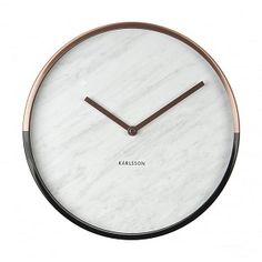 This on trend white & grey marble effect wall clock with the clock's case half in gold and half in black.