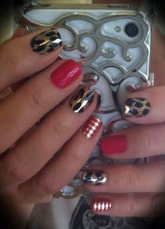 Metallic Leopard wrap and Cardinal lacquer. So trendy #nailart #diynails #jamberrynails
