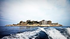 A deserted island, Gunkanjima, home to an abandoned coal facility.
