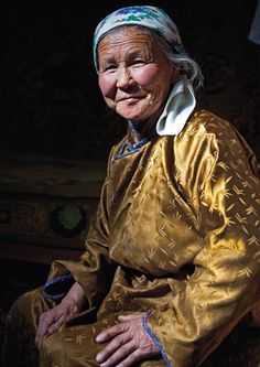 Portrait of a nomad woman in Taragt, Mongolia, wearing one of her best traditional Mongolian robes.
