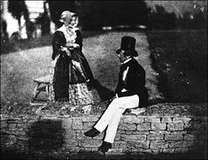 William Henry Fox Talbot.  Man and Woman sitting on garden wall in Lacock Abbey.  1835. Reproduction of calotype image.