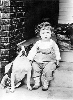 Little boy and a Boston Terrier