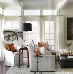 chair with sofa table.....new traditional family room by Courtney Giles
