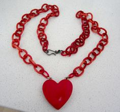 1930s Bakelite heart necklace (the Catalin chains usually disintegrate on these old Bakelite necklaces)