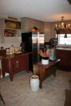 I have the red cabinet (from Pennsylvania of course - made by an amish man) as my kitchen island - never thought of putting against the wall...