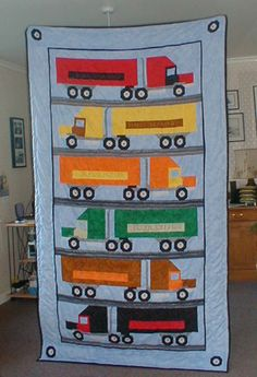 truck #quilt - great for little boys! Or maybe their truck driving daddy and put the companies hes driven for?