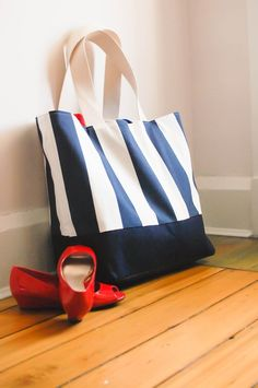 Large Beach Bag Navy and Cream StripesApprox 25 inches across the top x 17 inches across the bottom x 17 inches high x 7 inches wide -Handles are approx 24 inches end to end (12 inches high)