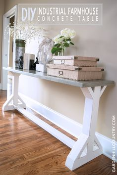 Here's all the information you need to build this DIY Industrial Farmhouse Concrete Console Table. The concrete table top brings warmth and style that can be transitional for just about any décor from industrial, to farmhouse, to contemporary, to coastal, and more. www.gardenhillcountry.com