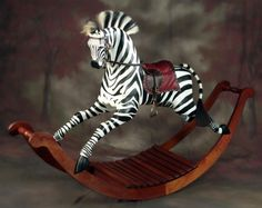From his studio in Texas Hill Country, Master Craftsman Al Carr sculpts classic Victorian rocking horses, safety gliders, and carousel horses with a distinctive twist from his west Texas roots. Rocking Horse Plans, Horse Swing, Wood Rocking Horse, Toy Box Plans, Carrousel, All The Pretty Horses, Carousel Horses, Hand Painted Rocks, Baby Cartoon