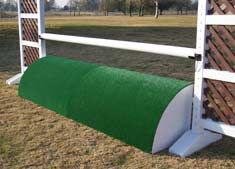 Artificial grass covers the curved surface, and the back side has a beautiful lattice pattern that will beautify any jump. The grass and the polyethylene frame withstand all weather conditions. Lightweight and easy to maneuver, these 2' high Roll Tops are available for 10' and 12' jumps. They come in two pieces that completely fill the space between your standards. www.horsejumps.net