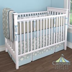 Crib bedding in Solid White Minky, Spa and Gray Fretwork, Solid Aqua, Solid Robin's Egg Blue, Solid White, French Gray Lyon, Solid Taupe. Created using the Nursery Designer® by Carousel Designs where you mix and match from hundreds of fabrics to create your own unique baby bedding. #carouseldesigns