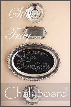 StoneGable: A WARM WELCOME~ SILVER TRAY CHALKBOARD.  Wonder how she hung these silver pieces on the wall??