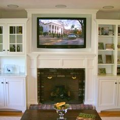 TV mounted above fireplace in custom cabinet with In-ceiling speakers. | Yelp