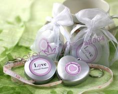 """Love Beyond Measure"" Measuring Tape Keychain in Sheer Organza Bag A gift to be enjoyed by all! Not only will these creative favors look splendid at a place setting, but your guests will find them as a useful tool to have around the house. Each compact measuring tape retracts at the push of a button and can easily be stored in a purse or on a handyman's pegboard. Available in round or heart shapes, these useful favors double as a keychain and feature a label that reads ""Love Beyond Measure""."