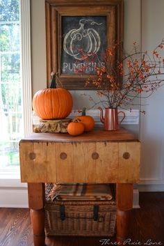 I love the pumpkin drawn on the old weathered wood framed chalkboard! From Three Pixie Lane: Pumpkins, Pumpkins and More Pumpkins