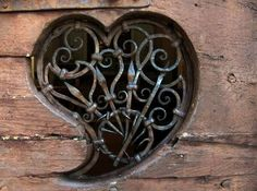 heart window with wrought iron