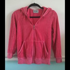 Juicy Couture velour pink zip up jacket Juicy Couture pink velour zip up jacket. Good condition! No rips stains or snags.3/4 length sleeves Juicy Couture Tops Sweatshirts & Hoodies