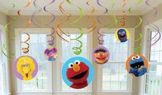 "Includes: (6) hanging swirls with cutouts (24"""") and (6) foil hanging swirls (18""""). This is an officially licensed Sesame Street product."