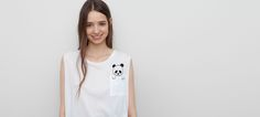 PRINTED T-SHIRT WITH POCKET - T-SHIRTS AND TOPS - WOMAN - PULL&BEAR Romania