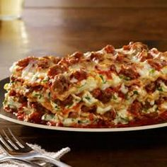 Johnsonville Italian All Natural Ground Sausage Lasagna Recipe Main Dishes with lasagna noodles, ground sausage, onion, chopped garlic, chunky pasta sauce, ricotta cheese, eggs, grated parmesan cheese, fresh spinach, shredded mozzarella cheese