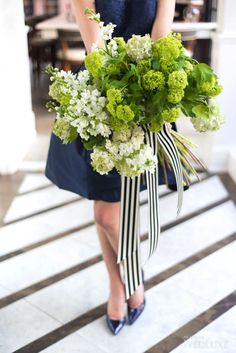 A bountiful green and white #bouquet wrapped with a chic striped ribbon | Photography by: 5ive15ifteen Photo Company | WedLuxe Magazine