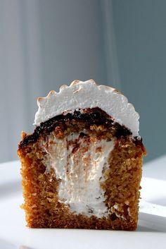 S'more cupcake - graham cracker cupcake, marshmallow filling, chocolate glaze, and marshmallow meringue.