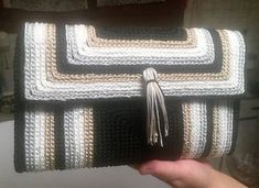 Womens crocheted bobbin purse with a crochet on a 0.5 mm plastic canvas. Made with propylene thread for handbags, in 4 colors; black, gray, white and beige gold. It has a magnetic clasp. A very stylish and beautiful bag that every woman would like to have in her hand for her outings.