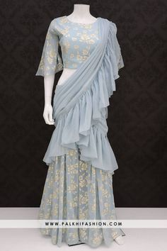 Light blue designer palazzo saree flowing ruffle pattern and appealing embossed prints. The readymade blouse made with matching prints Half Saree Designs, Kurta Designs, Saree Blouse Designs, Stylish Sarees, Stylish Dresses, Fashion Dresses, Ethnic Outfits, Indian Outfits, Indian Designer Outfits