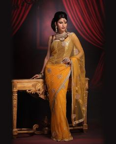Beautiful Yellow Saree..would love to wear one..