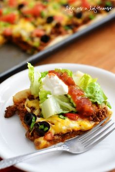 Taco Pizza. i would probs bake w/o tomatoes and add all the veggies after it was hot and melty.
